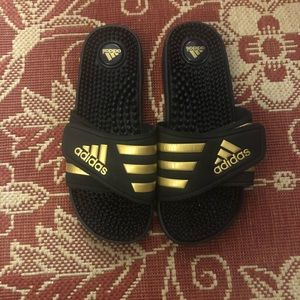 Never worn adidas gold and black adissage sandals